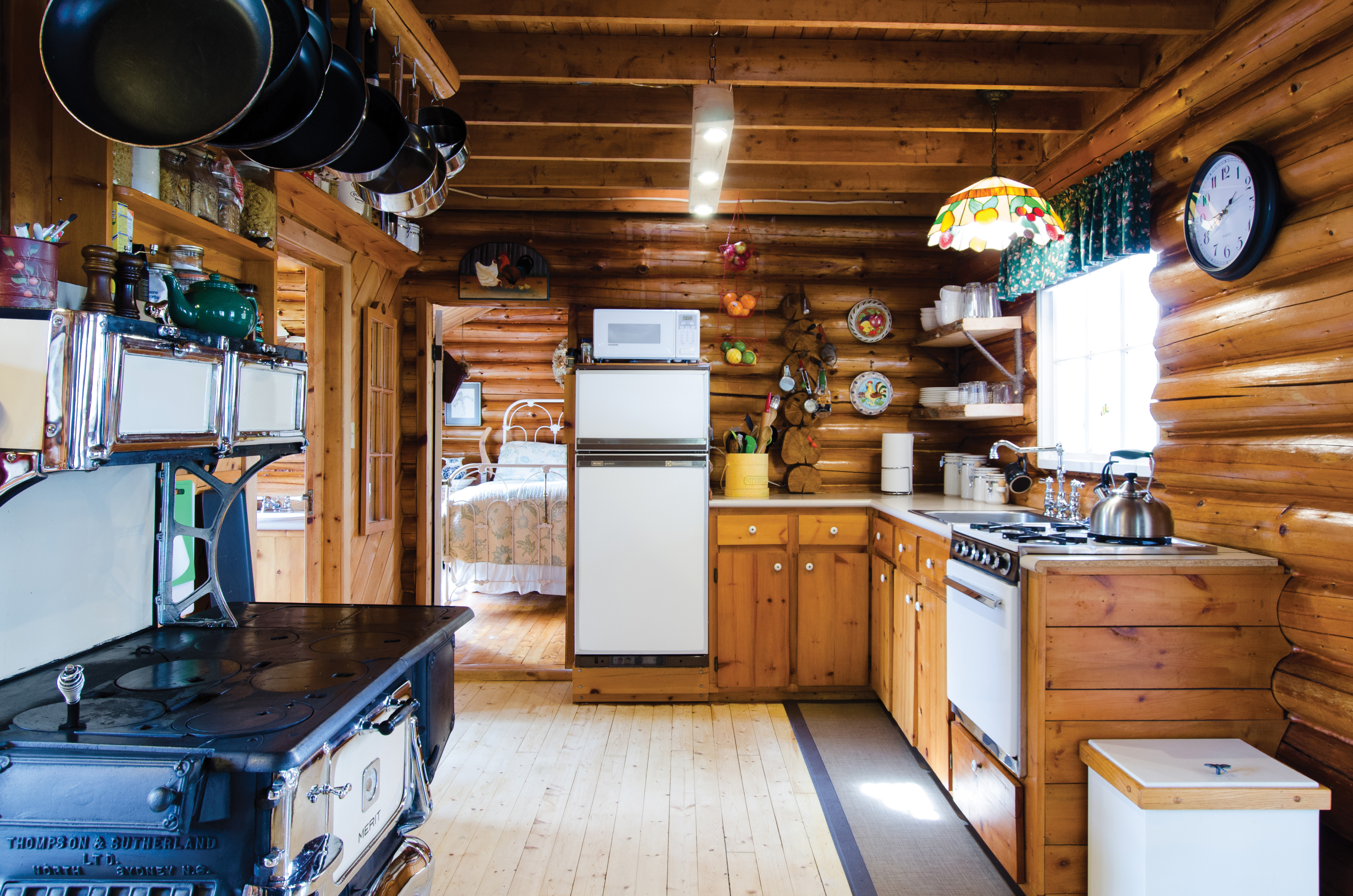 Cabin tour a rustic off grid log cabin in the woods for Off grid cabin foundation
